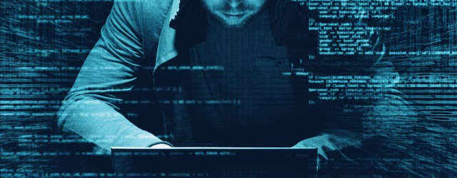 cybercriminal hacking into computer